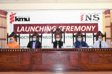 01.Minister of Health Taimur Salim Jhagra along with VC KMU Prof Dr Zia ul Haq and other sitting on stage during PhD Launching Ceremony1604146039.JPG