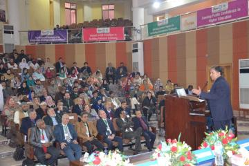 03- Sectery HED Syed Zafar Ali talking to Conferece while  VC KMU, Member Ops & Planing Dr Ghulam Raza Bhatti setting on stage during first International conference on qulaity assurance (Custom)1513657699.JPG