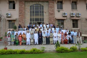 03.Group Photo of Prof Arshad Javed VC KMU along with Prof Daud Khan  andProf Hafizullah Ex VCs  and staff of KMU during Welcome party (Custom)1501818081.JPG
