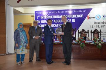 04- VC KMU Prof. Dr Arshad Javaid presented shield to Dr. Heinz Ulrich Schmidt special representative for Internal business Administeration Accreditation (FIBAA) (Custom)1513657699.JPG