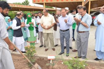 3.VC KMU Dr Arshad Javaid offering dua during  opening ceremony of tree plantation compaign at KMU (Custom)1534403633.JPG