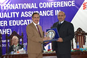 03- VC  KMU Dr. Arshad Javiad presenting seveniour to Chairman Pakistan science Foundation during concluding session of 1st Internation Conferenc on Quality Assurance (Custom)1514451798.JPG