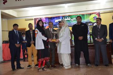 07-Vice Chancellor KMU & D.G Sports presenting cups to candidates (Custom)1514868434.JPG