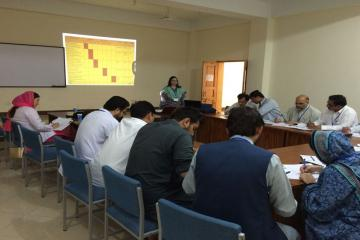 workshop participants carrying out exercises on objectives and TOS